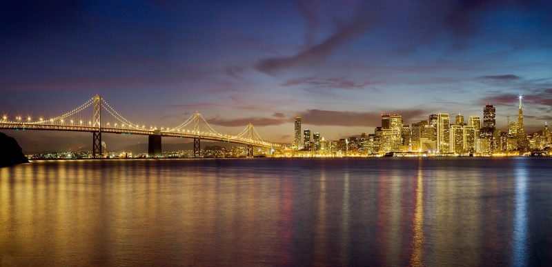 San francisco bay bridge city front at night