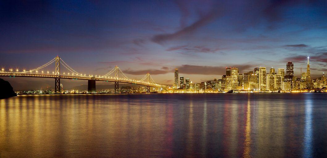 San francisco bay bridge city front at night