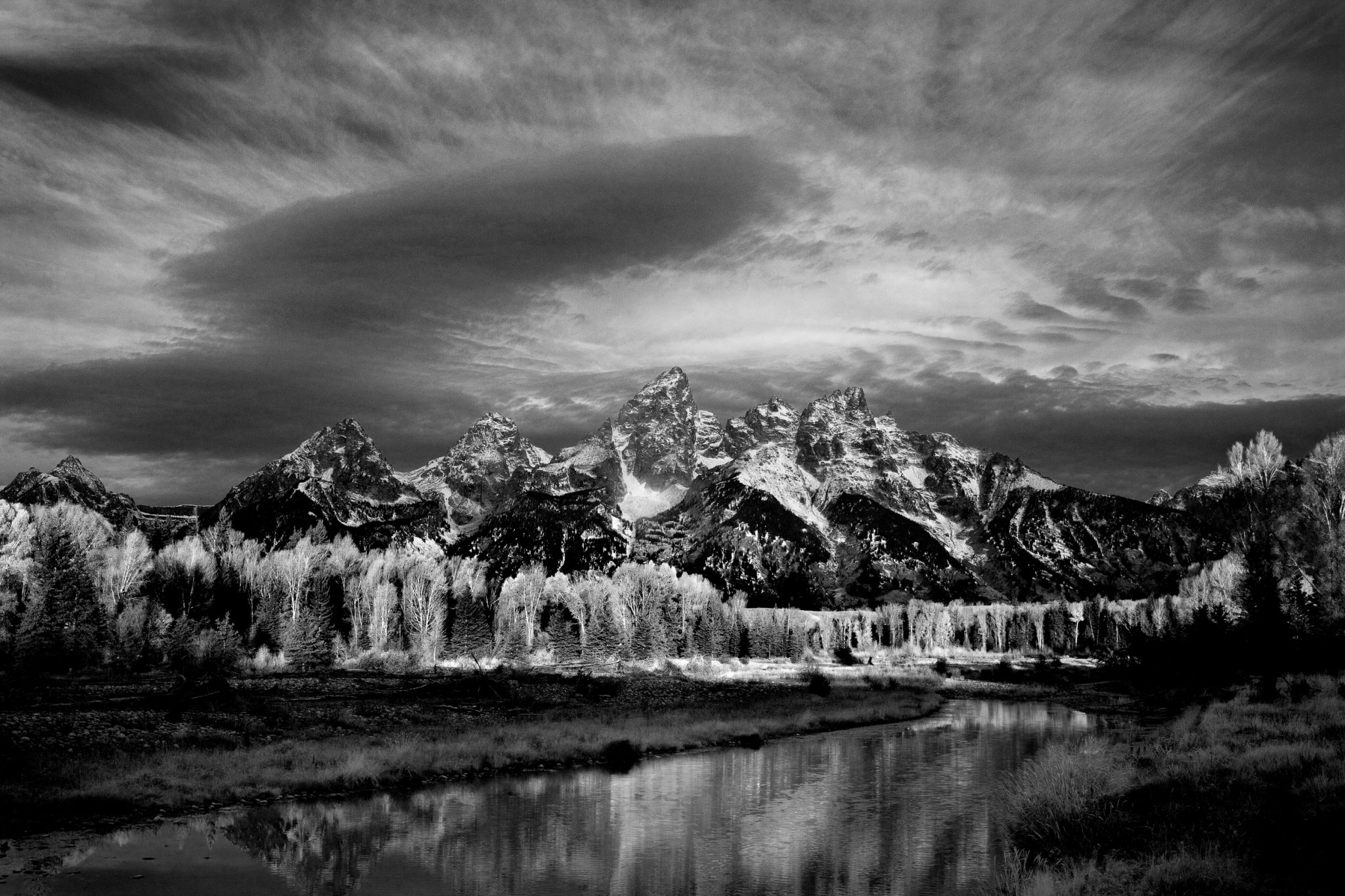 Schwabacher Sunrise - Storm clouds gather at dawn as seen from the Snake River Teton National Park - Wyoming