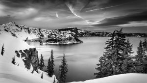 winter snow and dramatic sky Crater Lake