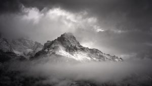 "The ""Sisters"" (the little peaks in the middle of the mountain) endure a stormy morning in the Tetons"